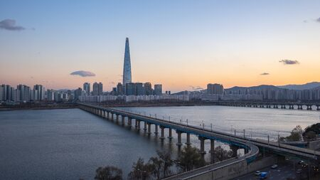 Seoul cityscape with Han River at sunset in South Korea.
