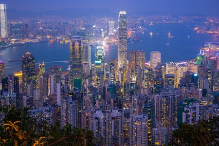 Hong Kong city skyline with landmark buildings at night in Hong Kong. 版權商用圖片
