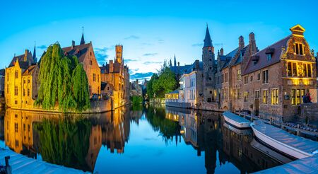 Bruges skyline with old buildings at night in Bruges, Belgium. 版權商用圖片