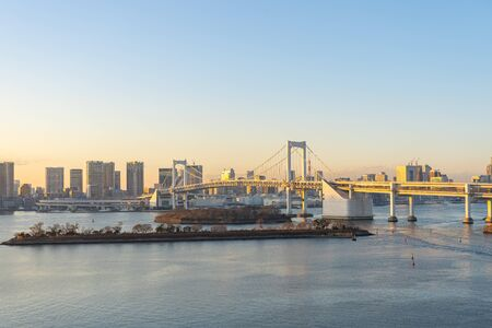 Tokyo skyline with view of Rainbow bridge in Japan.