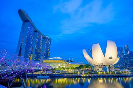 Singapore, Singapore - October 23, 2016: Landmark buildings at night in Singapore city.