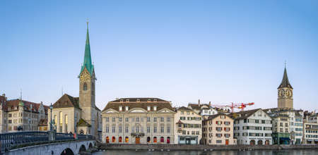 Panorama view of Zurich city skyline with view of Fraumunster church in Switzerland.
