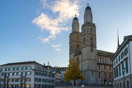 Grossmunster church with city skyline in Zurich, Switzerland.