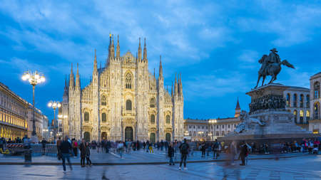 Duomo of Milan at night with crowd of people in Milan, Italy. 版權商用圖片