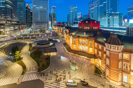 Tokyo Station with modern buildings in Tokyo city, Japan at night.