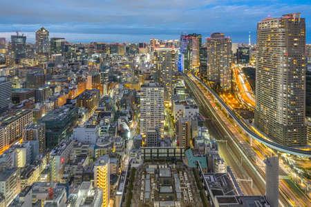 Tokyo city skyline with landmark buildings in Tokyo, Japan at night.