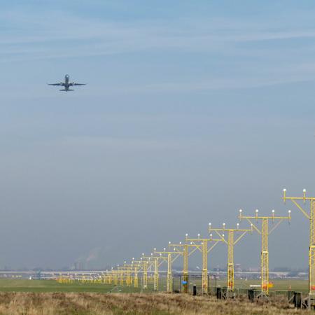 Plane leaving the airport Фото со стока