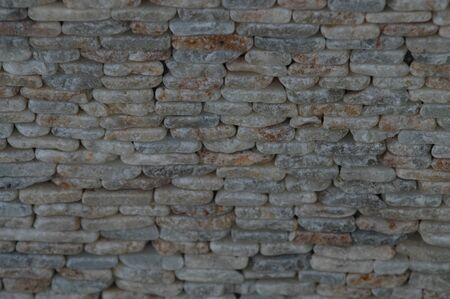 designates: Wall lined with stone as background