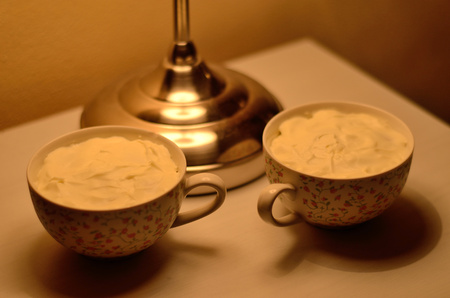 Two cups on the bedside table Stock Photo