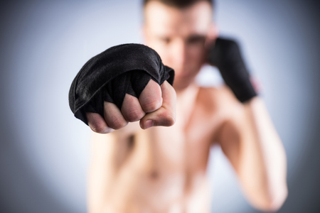 Fighters fist. Close-up. Bokeh. photo
