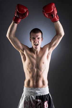 Boxing. Muscular fighter. Victory. photo