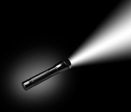 mag: Aluminum flashlight in night on black background