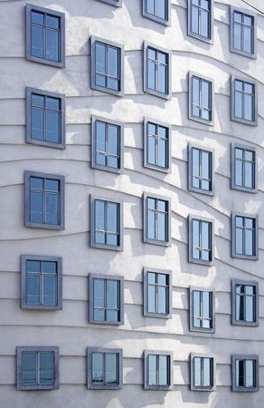 Modern architecture - windows on the dancing house Stock Photo - 2029586