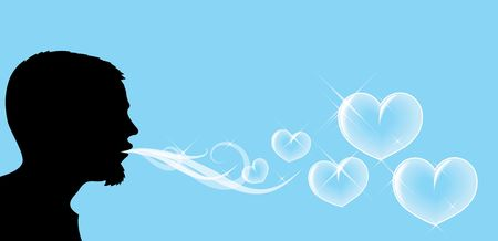 Silhouette of the man, who is blowing soap hearts rnrn photo