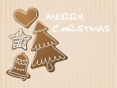 Christmas card - gingerbreads with white icing on light brown background photo