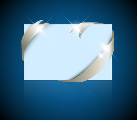 where: Christmas or wedding card - silver ribbon around blank blue paper, where you should write your text