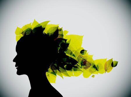 Foliage girl head silhouette (spring leafs) photo