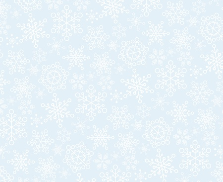 Christmas pattern made from white snowflakes on the light blue background Vector