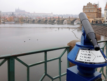 czech republic coin: Coin operated binoculars with The old city of Prague, capital of Czech Republic Stock Photo