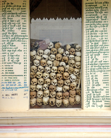 SIEM REAP, CAMBODIA - December 22, 2013 : The 'killing fields' memorial with glass windows housing the skulls and bones of some of those who perished during the period. Sajtókép