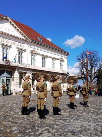 guarded: Budapest, Hungary - March 03, 2014 : Presidential guard Budapest, Hungary. Hungarys presidential office in the Castle District is heavily guarded by presidential guards. Editorial