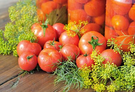 Tomatoes. Canned tomatoes. Glass jars with tomatoes. Vegetables on the table. Vegetable for the winter.
