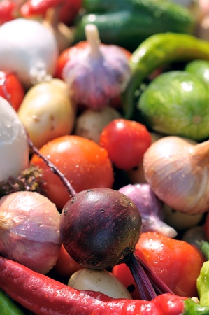 Vegetables on a wooden table. Tomatoes, peppers, onions on a wet table. Fresh vegetables. photo