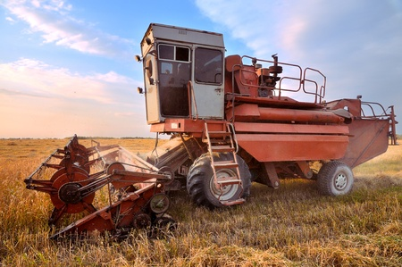 Combine Harvester. Combine harvesting. Agricultural machinery. Harvest. Farming in the field. photo