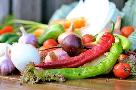 Vegetables on a wooden table. Cabbage, tomatoes, pepper, garlic on a wet table. Fresh vegetables. photo