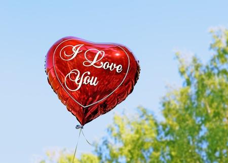 Balloon heart. Red balloon in shape of heart.  Stock Photo