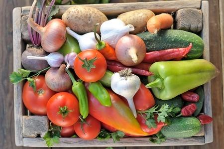vegetables in a wooden box. harvest vegetables.