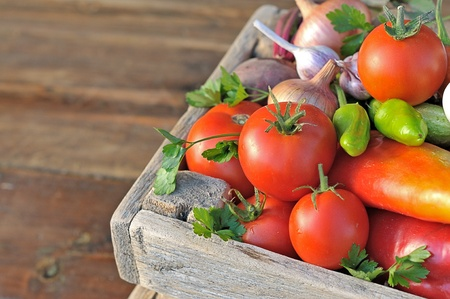 Ripe vegetables in a wooden box photo