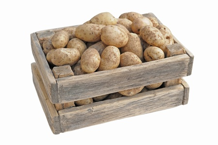 Potatoes in a box on a white background. Stock Photo