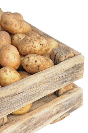 Potatoes in a wooden box. Stock Photo