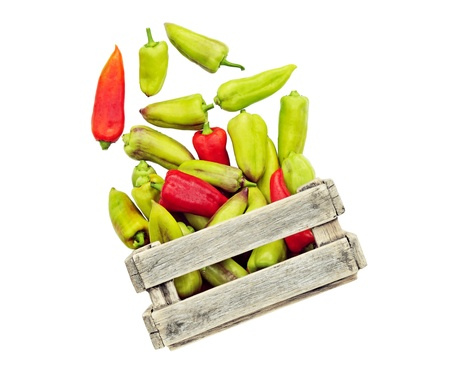 Soaring vegetable. Pepper in a box isolated. Bright vegetables on a white background. Pepper departing from the box.  Stock Photo - 11365385