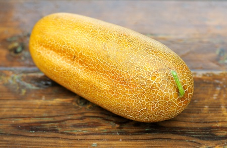 seminal: Breeding of cucumber. Ripe cucumber with the seeds. Cucumber on a wooden table. Stock Photo