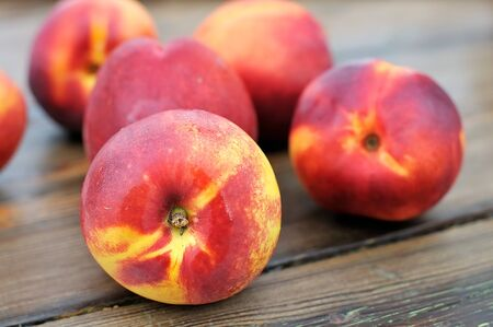 Ripe peaches on the table.