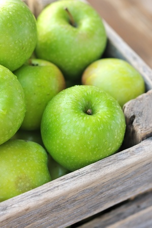 Green apples in a wooden box. Stock Photo - 11365391