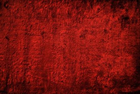 Red velvet cloth. The texture of velvet.
