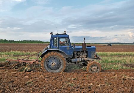 plough land: Plowing the land. Agricultural work. Stock Photo