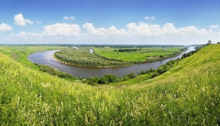 The view from the highest hill on a bend of the river. Panorama of the river and water meadows. photo