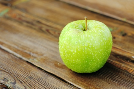 green apple on a wooden table. Stock Photo - 12566662