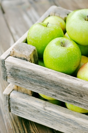 Apples in the box. Green apples on a wooden table. Stock Photo - 12566708
