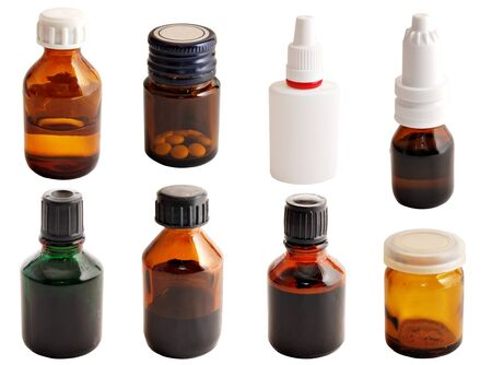 Medical drugs  Drugs in glass bottles of various shapes on a white background  photo