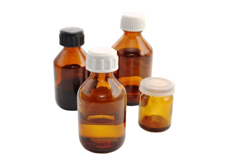 glass bottles of medicines on white background photo
