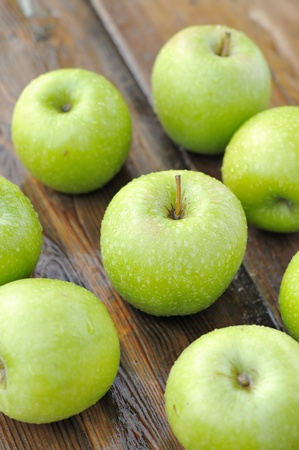 Fresh  apples on wooden table Stock Photo - 12566862