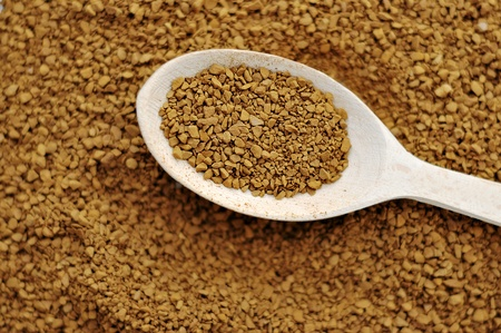 Granule coffee and a wooden spoon  Stock Photo