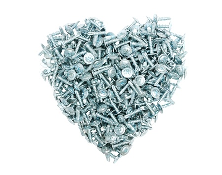 The heart of the metal screws on a white background  Chrome isolated heart  Symbol of love to technical progress  photo