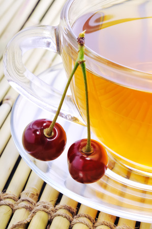 Green tea with cherries. Morning breakfast. Stock Photo