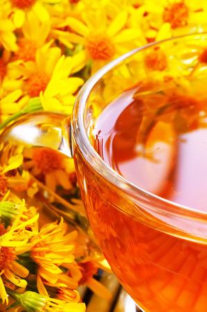 Herbal tea with flowers. Golden tea.